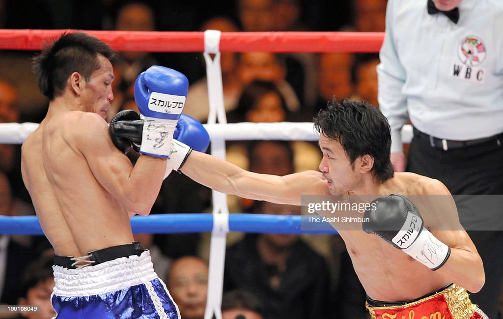 Champion Shinsuke Yamanaka of Japan (R) hits his right on challenger Malcolm Tunacao of the Phillipines during the World Boxing Commission (WBC) Bantamweight title bout at Ryogoku Kokugikan on April 8, 2013 in Tokyo, Japan.