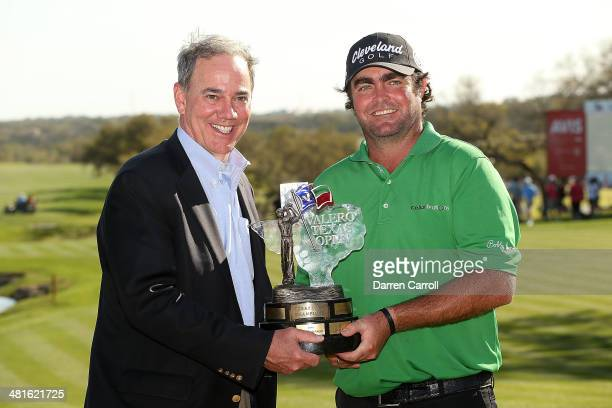 Champion Steven Bowditch poses with President of Valero Energy Company Joe Gorder and the trophy during the Final Round of the Valero Texas Open at...