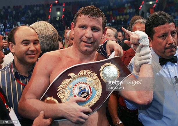 WBO champion Sultan Ibragimov of Russia celebrates his victory over former boxing champion Evander Holyfield of USA during their World Boxing...