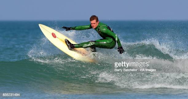Champion surf boarder Mark 'Egor' Harris from Newquay tries out an environmentally friendly surfboard off Fistral Beach Newquay