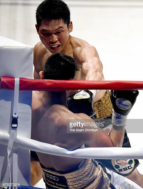 Champion Takashi Miura of Japan and challenger Billy Dib of Australia exchange puches duing the WBC world super featherweight title bout between...