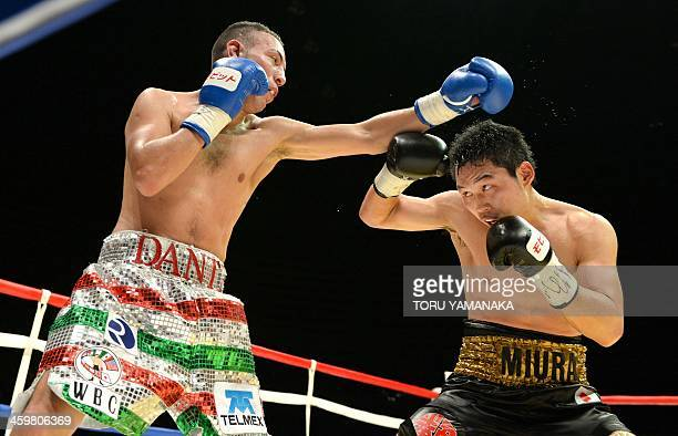 Champion Takashi Miura of Japan and challenger Dante Jardon of Mexico exchange blows during the eighth round of their WBC super featherweight title...