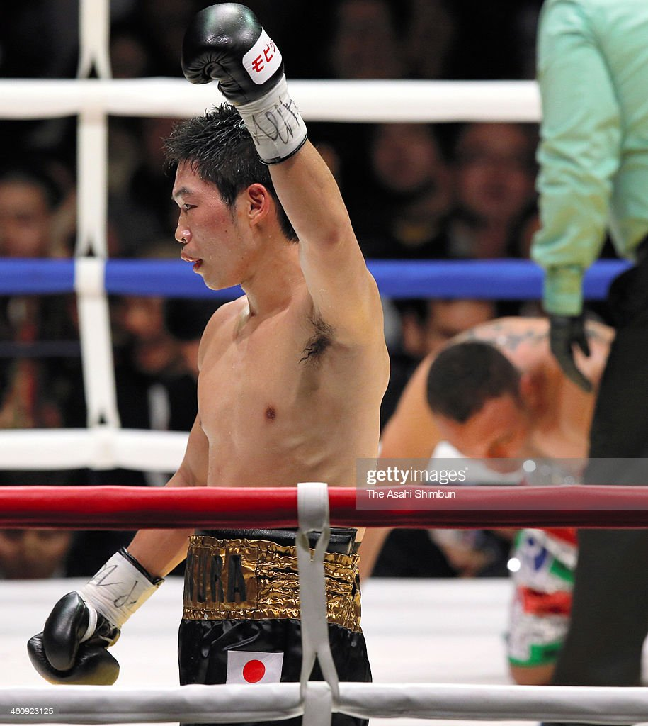 Champion Takashi Miura of Japan celebrates the win over Dante Jardon of Mexico with his son after their WBC Super Featherweight title at Ota-City General Gymnasium on December 31, 2013 in Tokyo, Japan.