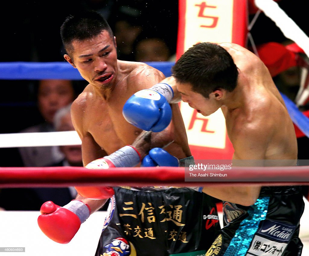 Champion Takashi Uchiyama (L) and challenger Daiki Kaneko exchange punches during their WBA Super Featherweight title at Ota-City General Gymnasium on December 31, 2013 in Tokyo, Japan.