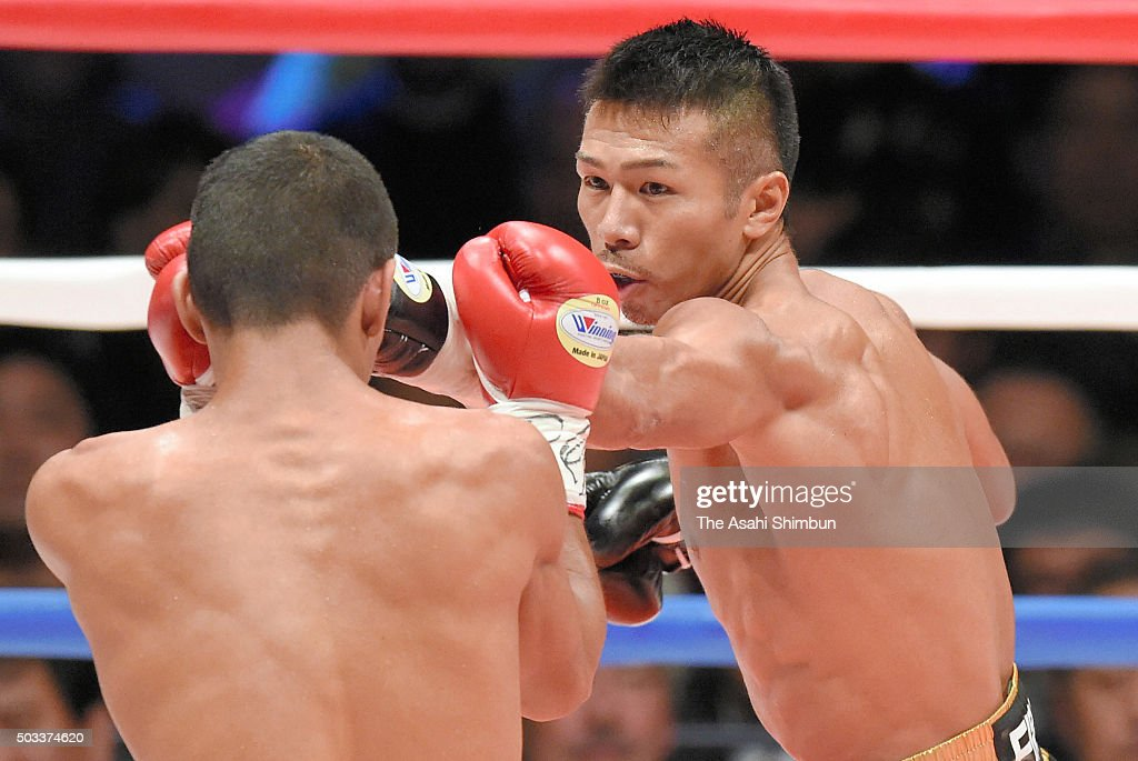 Champion <a gi-track='captionPersonalityLinkClicked' href=/galleries/search?phrase=Takashi+Uchiyama&family=editorial&specificpeople=6963680 ng-click='$event.stopPropagation()'>Takashi Uchiyama</a> (R) of Japan and challenger Oliver Flores of Nicaragua (L) exchange punches during the WBA Super Featherweight title bout at the Ota-City General Gymnasium on December 31, 2015 in Tokyo, Japan.