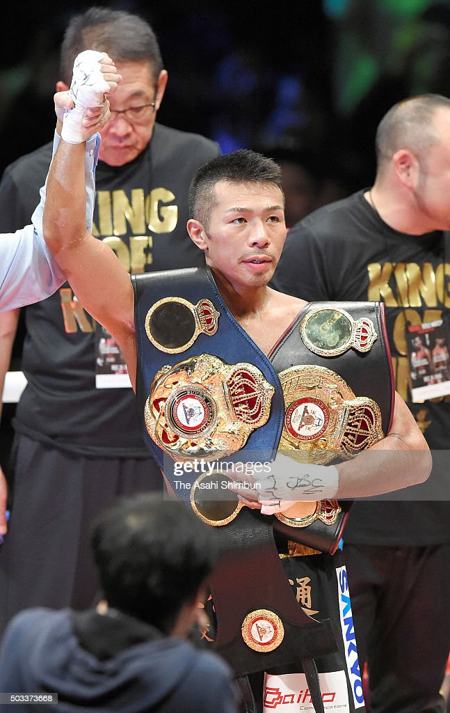 Champion <a gi-track='captionPersonalityLinkClicked' href=/galleries/search?phrase=Takashi+Uchiyama&family=editorial&specificpeople=6963680 ng-click='$event.stopPropagation()'>Takashi Uchiyama</a> of Japan celebrates after technical knockout win against challenger Oliver Flores of Nicaragua in the WBA Super Featherweight title bout at the Ota-City General Gymnasium on December 31, 2015 in Tokyo, Japan.
