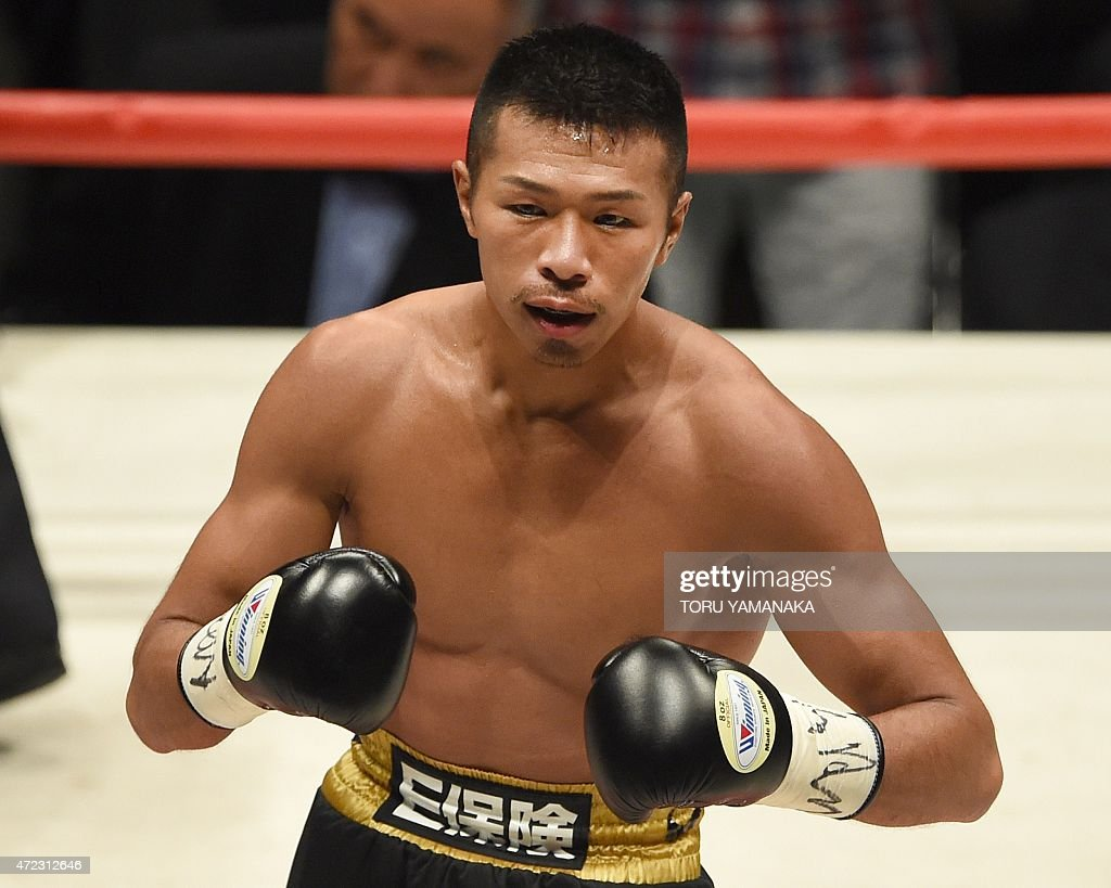Champion <a gi-track='captionPersonalityLinkClicked' href=/galleries/search?phrase=Takashi+Uchiyama&family=editorial&specificpeople=6963680 ng-click='$event.stopPropagation()'>Takashi Uchiyama</a> (C) of Japan reacts after his victory over his Thai challenger Jomthong Chuwatana during the second round of the WBA super featherweight title bout in Tokyo on May 6, 2015 AFP PHOTO / Toru YAMANAKA