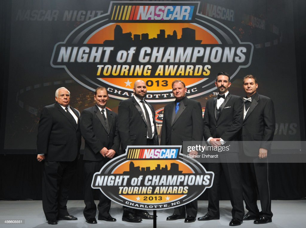 Champion Team Owner honorees pose for a photograph during the NASCAR Night of Champions at Charlotte Convention Center on December 14, 2013 in Charlotte, North Carolina.