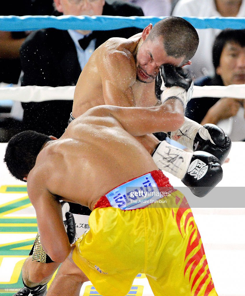 Champion Tepparith Kokietgym (F) of Thailand hits his light on challenger Nobuo Nashiro of Japan during the WBA Super Flyweight Title Match at Sumiyoshi Sports Center on September 1, 2012 in Osaka, Japan.