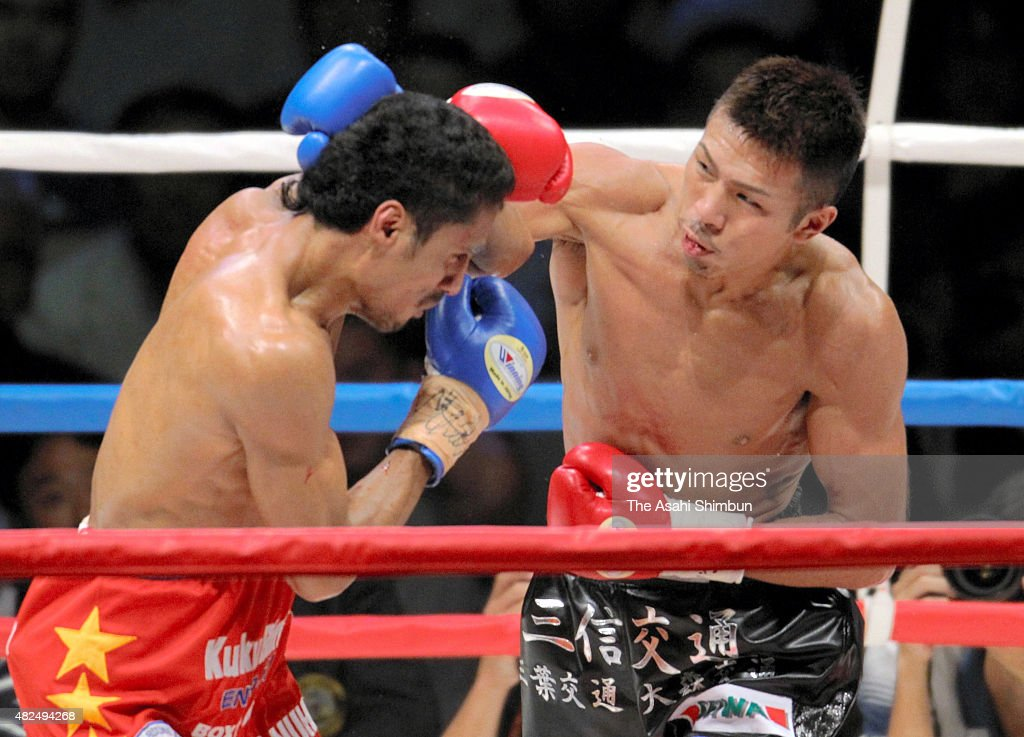 Champion Tkaashi Uchiyama (R) of Japan hits his right on challenger Roy Mukhlis (L) of India during their WBA Super Featherweight title bout at Saitama Super Arena on September 20, 2010 in Saitama, Japan.