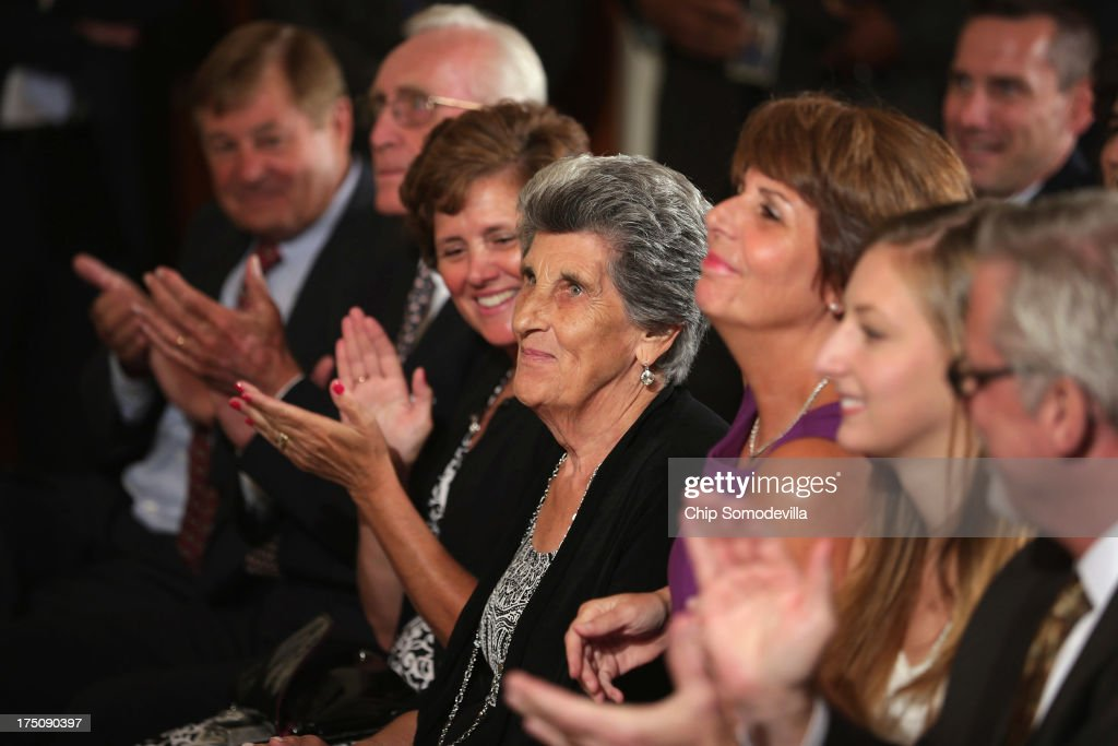 NCAA champion University of Connecticut Huskies Women's basketball head coach Geno Auriemma's mother, Marciella Auriemma (C), sits in the front row to watch her son's team being honored by President Barack Obama in the East Room of the White House July 31, 2013 in Washington, DC. Obama hosted the team after they defeated the University of Louisville on April 9 to win their eighth national championship.