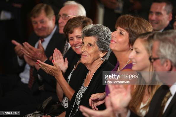 NCAA champion University of Connecticut Huskies Women's basketball head coach Geno Auriemma's mother Marciella Auriemma sits in the front row to...