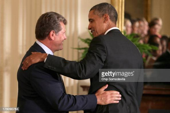 NCAA champion University of Connecticut Huskies Women's basketball head coach Geno Auriemma thanks President Barack Obama after he hosted the team in...