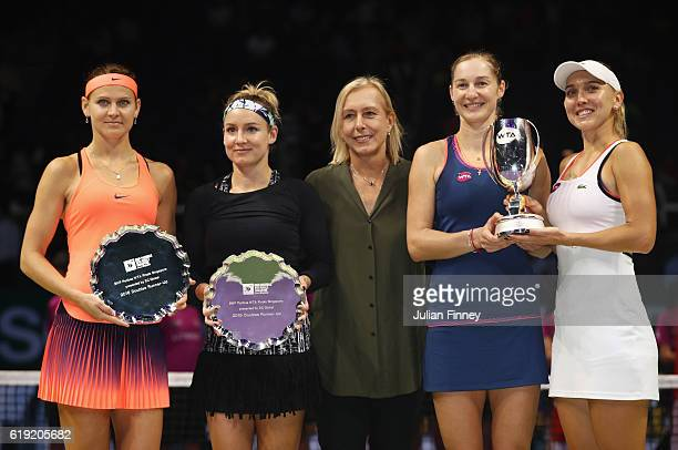 Champions Ekaterina Makarova and Elena Vesnina of Russia pose with Bethanie MattekSands of the United States and Lucie Safarova of Czech Republic and...
