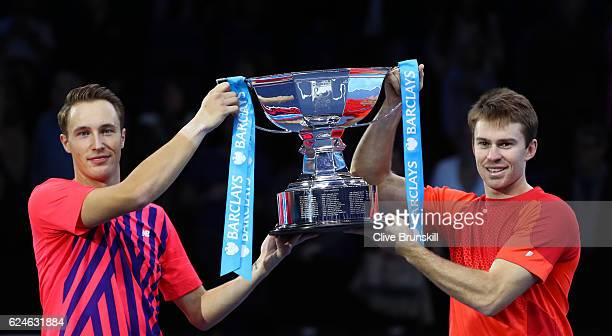 Champions Henri Kontinen of Finland and John Peers of Australia lift the trophy following the Doubles Final against Raven Klaasen of South Africa and...