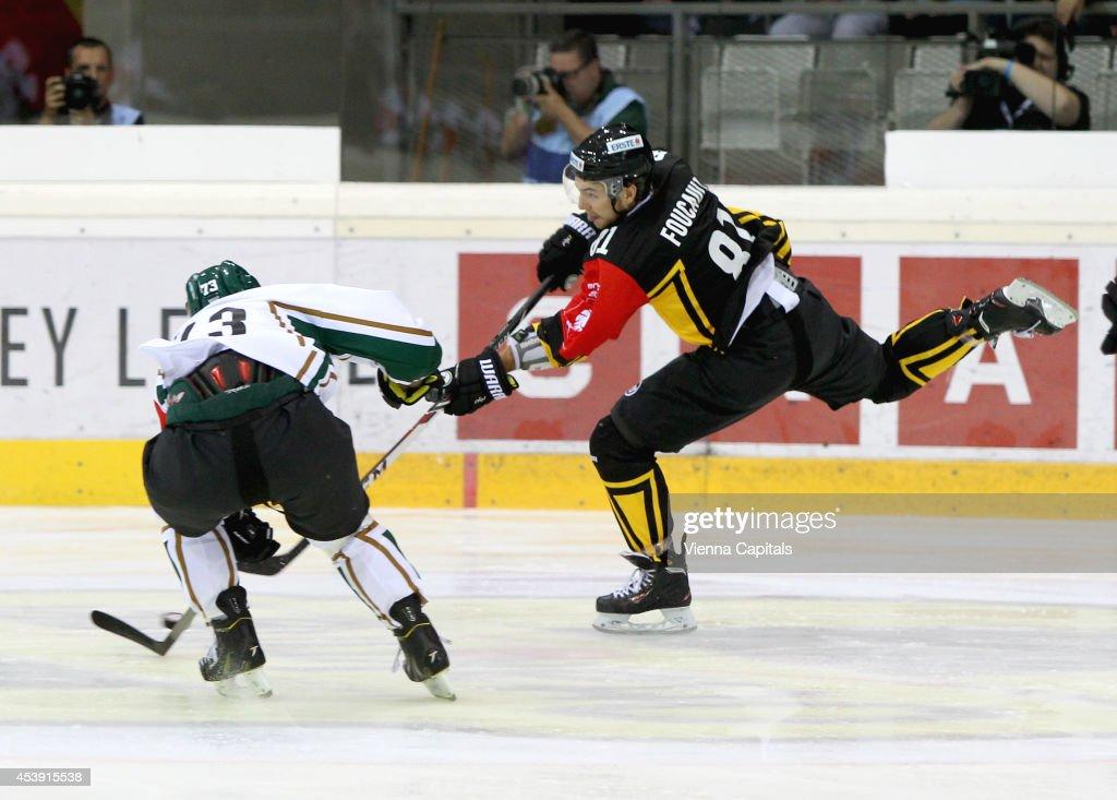HOCKEY - Champions Hockey League, group stage, EV Vienna Capitals vs Faerjestad BK. Image shows Anton Grundel (Faerjestad) and Kris Foucault (Capitals). Photo: Vienna Capitals, GEPA pictures/ Christian Ort