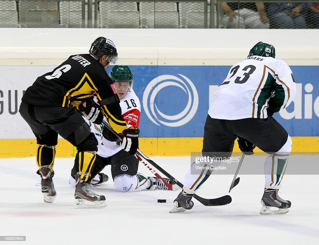 Champions Hockey League, group stage, EV Vienna Capitals vs Faerjestad BK. Image shows Rafael Rotter (Capitals), Joakim Nygaerd and Martin Ryoemark (Faerjestad) on August 21, 2014 in Vienna, Austria.