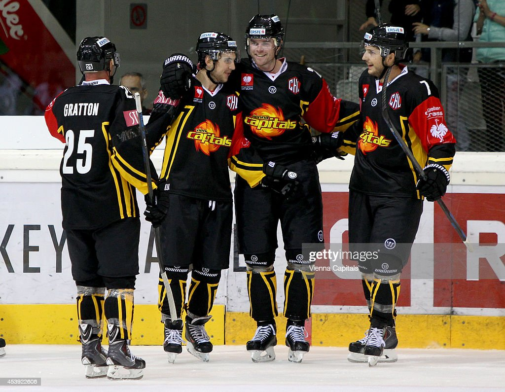 Champions Hockey League, group stage, EV Vienna Capitals vs Faerjestad BK. Image shows the rejoicing of, Benoit Gratton, Kris Foucault, Hugh Jessiman and Brett Carson (Capitals) on August 21, 2014 in Vienna, Austria.