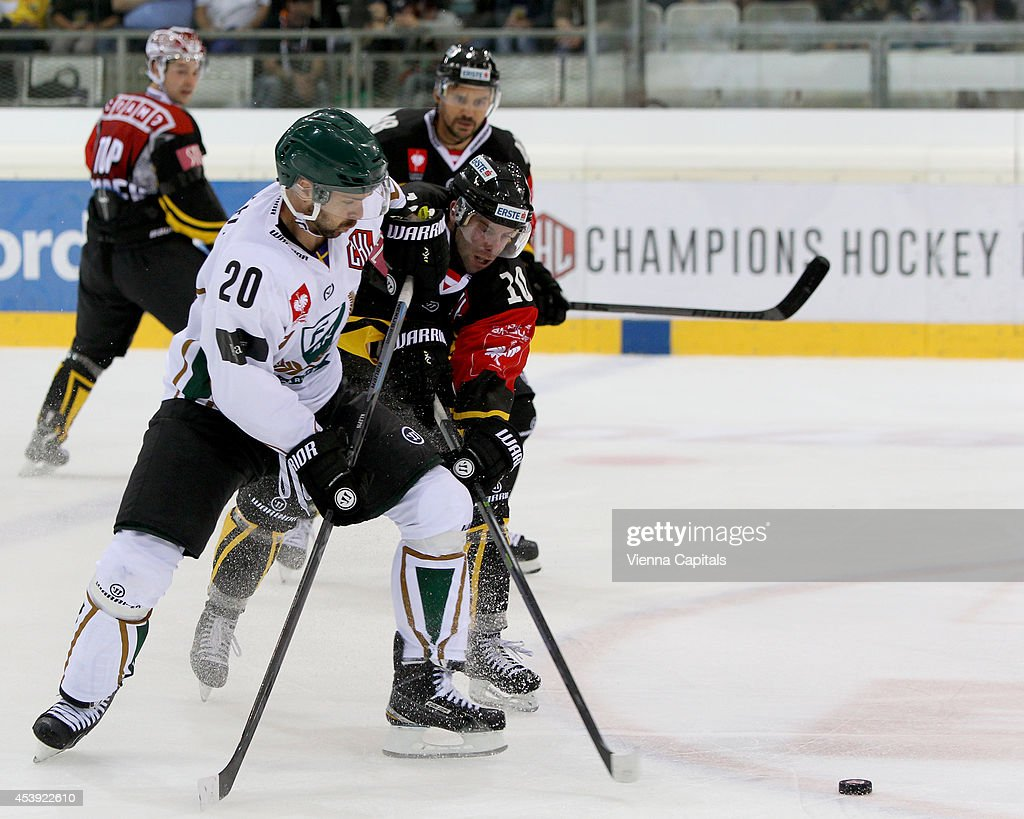 Champions Hockey League, group stage, EV Vienna Capitals vs Faerjestad BK. Image shows Jakub Klepis (Faerjestad) and Matt Watkins (Capitals) on August 21, 2014 in Vienna, Austria.