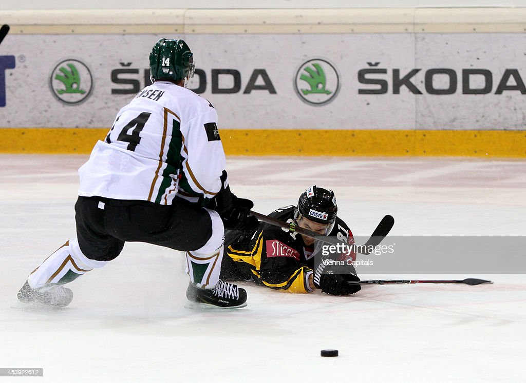 Champions Hockey League, group stage, EV Vienna Capitals vs Faerjestad BK. Image shows Jesper Jensen (Faerjestad) and Kris Foucault (Capitals) on August 21, 2014 in Vienna, Austria.