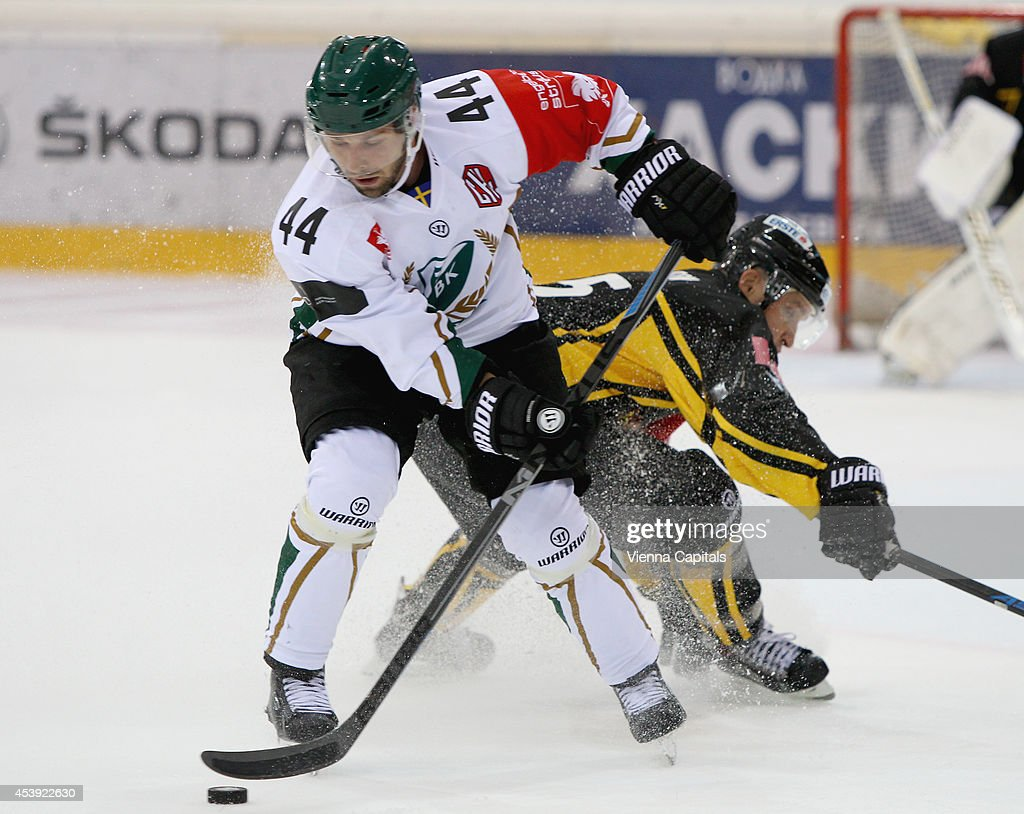Champions Hockey League, group stage, EV Vienna Capitals vs Faerjestad BK. Image shows Milan Gulas (Faerjestad) and Benoit Gratton (Capitals) on August 21, 2014 in Vienna, Austria.