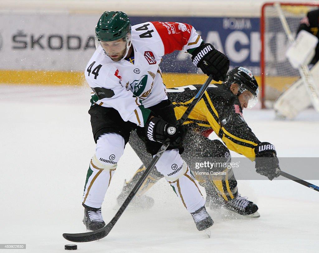 Champions Hockey League, group stage, EV Vienna Capitals vs Faerjestad BK. Image shows Milan Gulas (Faerjestad) and Benoit Gratton (Capitals) on August 21, 2014 in Vienna, Austria.
