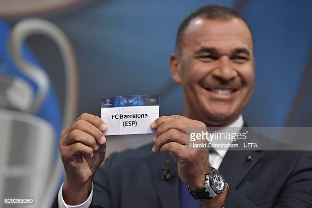 Champions League Ambassador Ruud Gullit draws out the name of Barcelona during the UEFA Champions League 2016/17 Round of 16 Draw at the UEFA...