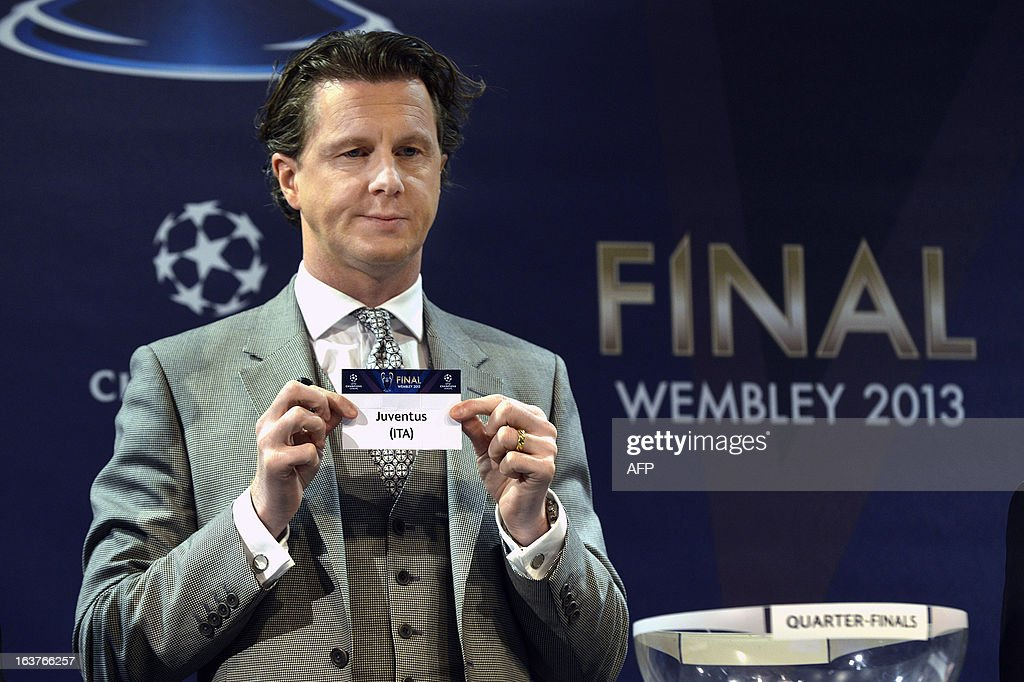 Champions League final ambassador Steve McManam shows the name of the Juventus football club during the draw for the quarter-finals of the UEFA Champions League on March 15, 2012 at the UEFA headquarters in Nyon. AFP PHOTO / SEBASTIEN FEVAL