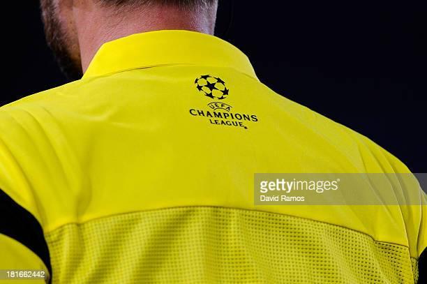 Champions League logo is seen on a match official during the UEFA Champions League Group A match between Real Sociedad de Futbol and FC Shakhtar...