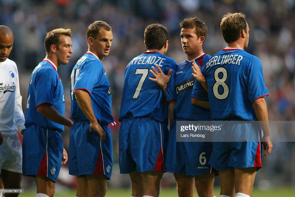 http://media.gettyimages.com/photos/champions-league-qual-glasgow-rangers-defending-fernando-ricksen-de-picture-id503979073
