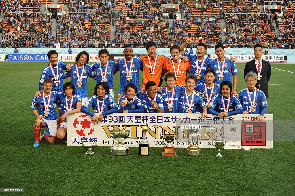 Champions of 93rd Emperor's Cup,Yokohama F.Marinos players pose for a photograph with the trophies after winning the 93rd Emperor's Cup final between Yokohama F.Marinos and Sanfrecce Hiroshima at the National Stadium on January 1, 2014 in Tokyo, Japan.