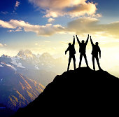 Sillhouettes of a champions on the high mountain. Sport and active life