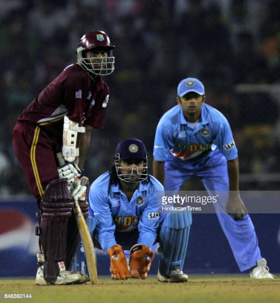 Shivnarine Chanderpaul takes stance while Mahendra Singh Dhoni and Rahul Dravid look on during the match against West Indies at Sardar Patel Gujarat...