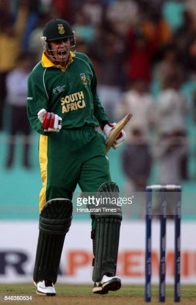 South African batsman Shaun Pollock react after hitting a six against Sri Lanka in the ICC Champions Trophy at the Sardar Patel Gujarat Stadium...