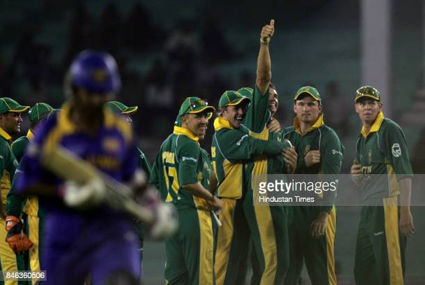 South African bowler Andre Nel celebrates with his team after taking wicket of Marvan Atapattu in the ICC Champions Trophy at the Sardar Patel...