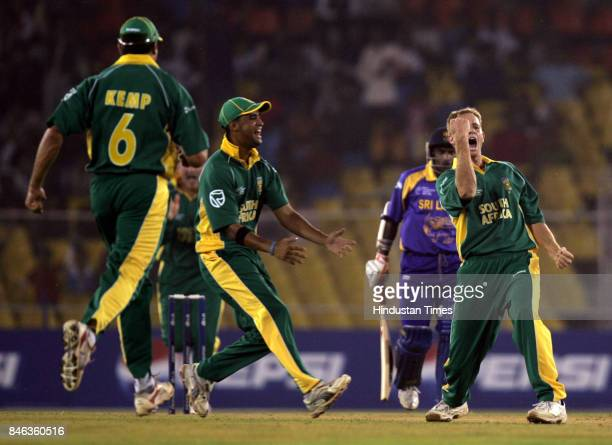 South African bowler Shaun Pollock reacts after taking wicket of Sanath Jayasuriya of in the ICC Champions Trophy at the Sardar Patel Gujarat Stadium...