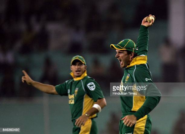South African Graeme Smith reacts after taking catch of Lasith Malinga in the ICC Champions Trophy at the Sardar Patel Gujarat Stadium Ahmedabad on...