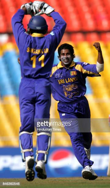 Sri Lankas bowler Chaminda Vaas celebrates after the dismissal of South African Boeta Dippenaar in the ICC Champions Trophy at the Sardar Patel...