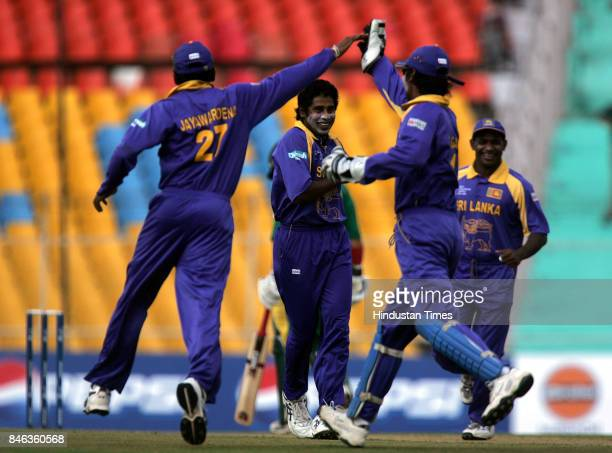 Sri Lankas bowler Chaminda Vaas celebrates after the dismissal of South African captain Graeme Smith in the ICC Champions Trophy at the Sardar Patel...