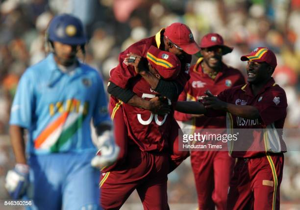 West Indies celebrate after Indian captain Rahul Dravid was run out during the match at Sardar Patel Gujarat Stadium Ahmedabad on Thursday