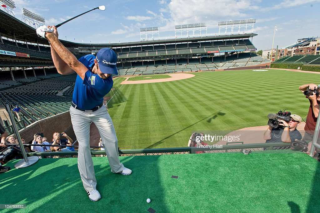 Championship defending champion <a gi-track='captionPersonalityLinkClicked' href=/galleries/search?phrase=Dustin+Johnson&family=editorial&specificpeople=3908453 ng-click='$event.stopPropagation()'>Dustin Johnson</a> tees off from a specially-constructed platform in the stands at Wrigley Field to mark the start of the 2011 BMW Championship. Johnson joined Cubs legend Ernie Banks in a historic challenge in which the pair attempted to make a hole-in-one in order to earn a $100,000 college scholarship for the Evans Scholars Foundation, a Chicago-based charity on September 12, 2011 in Chicago, Illinois.