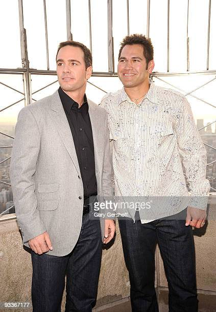 NASCAR championship driver Jimmie Johnson and New York Yankee Johnny Damon pose for pictures on the Empire State Building Observation Deck in...