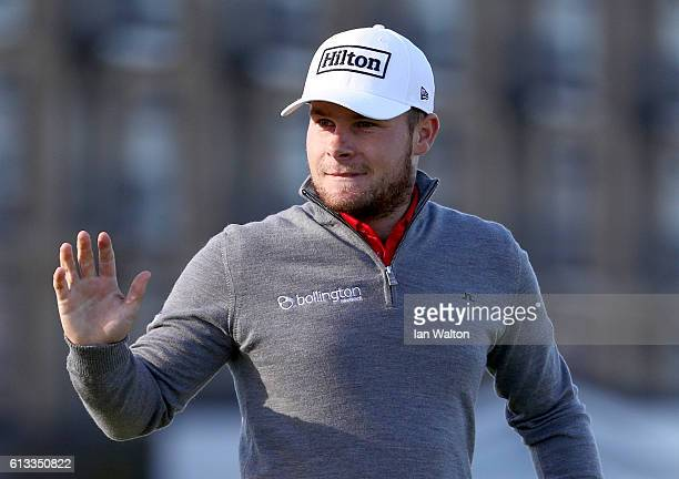 Championship leader Tyrrell Hatton of England acknowledges the crowd after holing his putt on the 17th green during the third round of the Alfred...