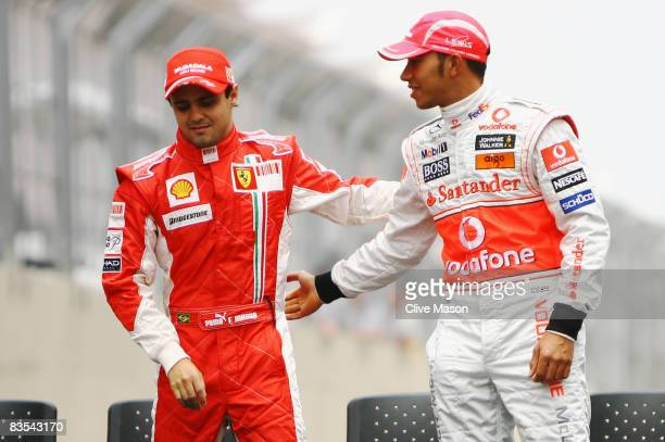 Championship rivals Felipe Massa of Brazil and Ferrari and Lewis Hamilton of Great Britain and McLaren Mercedes shake hands at the drivers end of...