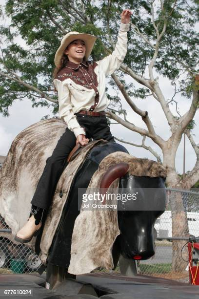 Championship Rodeo Girl on mechanical bull ride