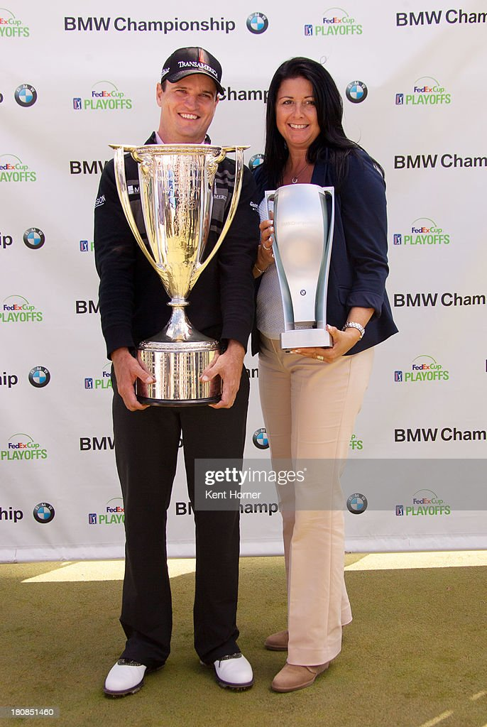 Championship winner <a gi-track='captionPersonalityLinkClicked' href=/galleries/search?phrase=Zach+Johnson+-+Golfer&family=editorial&specificpeople=217976 ng-click='$event.stopPropagation()'>Zach Johnson</a> and BMW of North America Vice President of Marketing Trudy Hardy hold the J.K. Wadley Trophy and BMW Trophy at Conway Farms Golf Club on September 16, 2013 in Lake Forest, Illinois.
