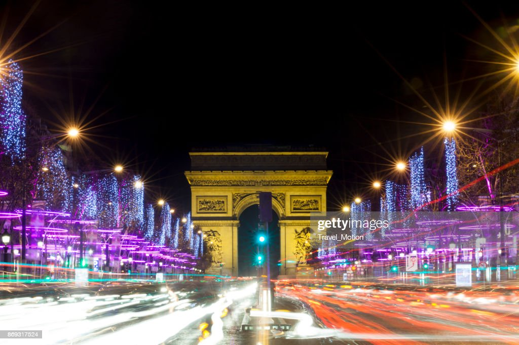 Champs-Elysees at night with traffic, Paris, France