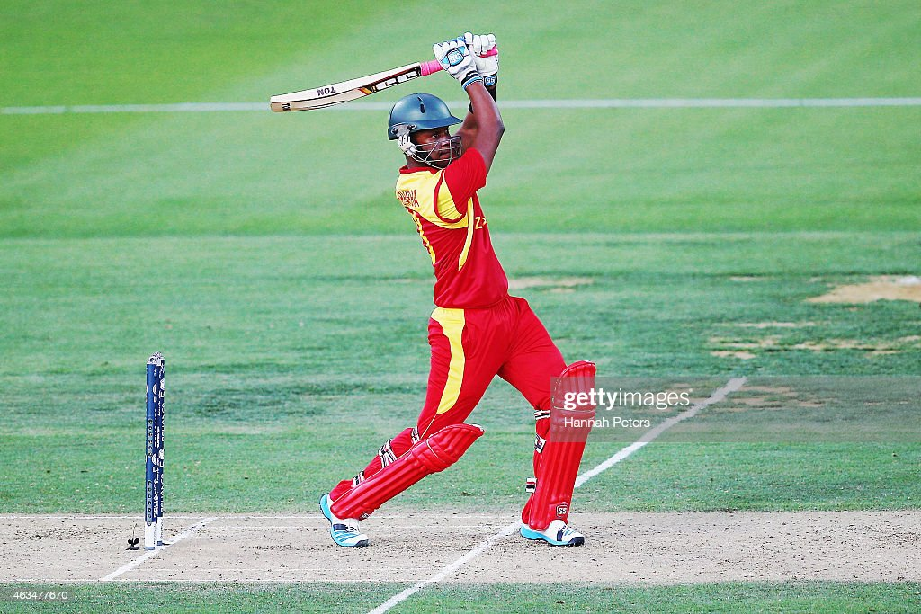 Chamu Chibhabha of Zimbabwe pulls the ball away for six runs during the 2015 ICC Cricket World Cup match between South Africa and Zimbabwe at Seddon...