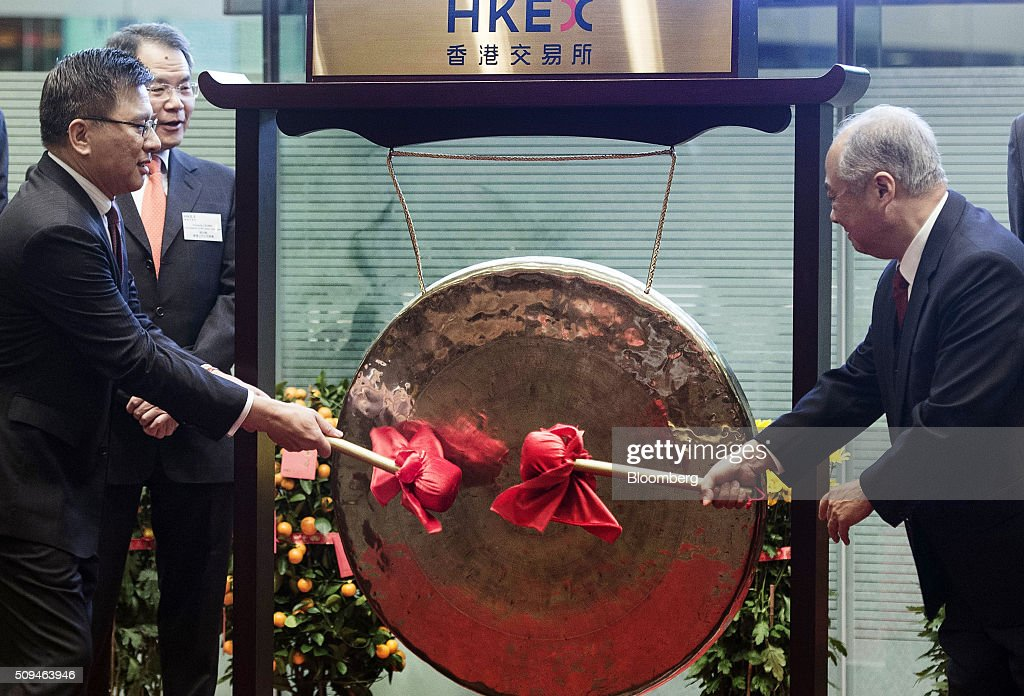 K.C. Chan, financial secretary of Hong Kong, left, and Chow Chung-Kong, chairman of Hong Kong Exchanges & Clearing Ltd. (HKEx), strike a gong to open the first day of trading after lunar new year at the bourse in Hong Kong, China, on Thursday, Feb. 11, 2016. Hong Kong stocks headed for their worst start to a lunar new year since 1994 as a global equity rout deepened amid concern over the strength of the world economy. Photographer: Xaume Olleros/Bloomberg via Getty Images