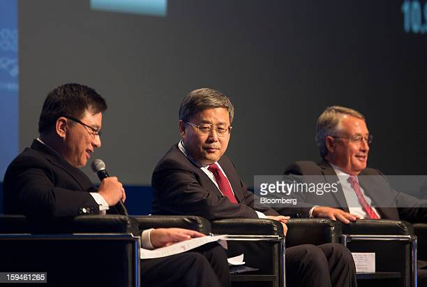 KC Chan Hong Kong's secretary for financial services and the treasury from left speaks while Guo Shuqing chairman of China Securities Regulatory...